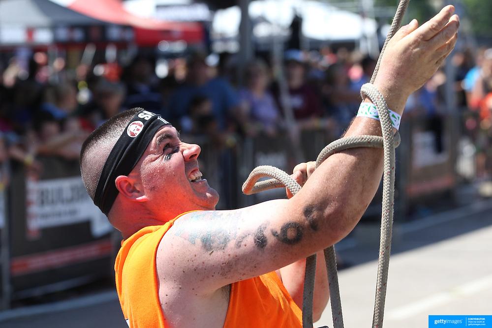 Kristopher Pedersen in action at the Herculean Hoist  obstacle during the Reebok Spartan Race. Mohegan Sun, Uncasville, Connecticut, USA. 28th June 2014. Photo Tim Clayton