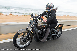 Klock Werks Karlee Kobb of SD riding her custom Indian Scout up AIA along the Atlantic Ocean during Daytona Beach Bike Week. FL. USA. Monday March 13, 2017. Photography ©2017 Michael Lichter.