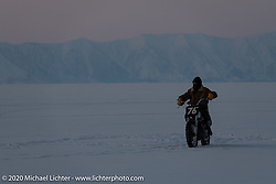 Moscow photographer Aleksei Kalabin riding his Kawasaki w650 racer after the Baikal Mile Ice Speed Festival. Maksimiha, Siberia, Russia. Friday, February 28, 2020. Photography ©2020 Michael Lichter.
