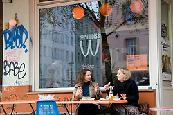 Exterior of Imbiss W a famous small cafe/restaurant on bohemian Kastaniellallee in Prenzlauer Berg in Berlin Germany. The cafe has used the upside down logo of McDonalds restaurants