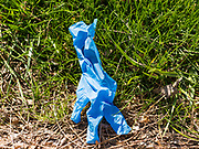 "01 APRIL 2020 - DES MOINES, IOWA: A used nitrile glove on the street in downtown Des Moines. On Sunday morning, 04 April, Iowa reported 786 confirmed cases of the Novel Coronavirus (SARS-CoV-2) and COVID-19. There have been 14 deaths attributed to COVID-19 in Iowa. Restaurants, bars, movie theaters, places that draw crowds are closed until 07 April. The Governor has not ordered ""shelter in place"" but several Mayors, including the Mayor of Des Moines, have asked residents to stay in their homes for all but the essential needs. People are being encouraged to practice ""social distancing"" and many businesses are requiring or encouraging employees to telecommute.         PHOTO BY JACK KURTZ"
