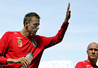 """Photo: Paul Thomas.<br /> England v Jamaica. International Friendly. 03/06/2006.<br /> <br /> Peter Crouch leaves the field with a """"hat-trick"""" of goals."""