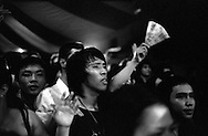 Nguu Cung, My Favorite Uncle and REGURGITATOR play at the CAMA festival. Vietnamese fans are entranced by the concert. American Club, Hai Ba Trung, Hanoi, Vietnam.