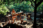 MEXICO, YUCATAN PENINSULA Mayan family washing clothes