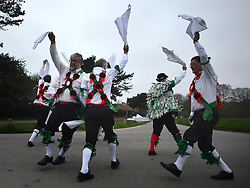 © Licensed to London News Pictures. 01/05/2013. Wimbledon, UK The Greensleeves Morris Men welcome in the dawn on May Day with a dance on Wimbledon Common, Surrey, 1st May 2013. Greensleeves were founded in 1926, making it one of the longest established Morris sides.Morris Men dance traditional English folk dance with bells, handkerchiefs, sticks and swords. . Photo credit : Stephen Simpson/LNP