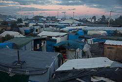 """So called îJungle"""" refugee camp on the outskirts of the French city of Calais on the weekend before the scheduled eviction. Many thousands of migrants and refugees are waiting in some cases for years in the port city in the hope of being able to cross the English Channel to Britain. French authorities announced that they will shortly evict the camp where currently up to up to 10,000 people live.<br /> <br /> Das sogenannte îJungleî Fluechtlingscamp am Rande der franzoesischen Stadt Calais, am Wochenende vor der angesetzten Raeumung. Viele tausend Migranten und Fluechtlinge harren teilweise seit Jahren in der Hafenstadt aus in der Hoffnung den Aermelkanal nach Groflbritannien ueberqueren zu koennen. Die franzoesischen Behoerden kuendigten an, dass sie das Camp, indem derzeit bis zu bis zu 10.000 Menschen leben K¸rze raeumen werden. <br /> <br /> Photo: Bjoern Kietzmann"""
