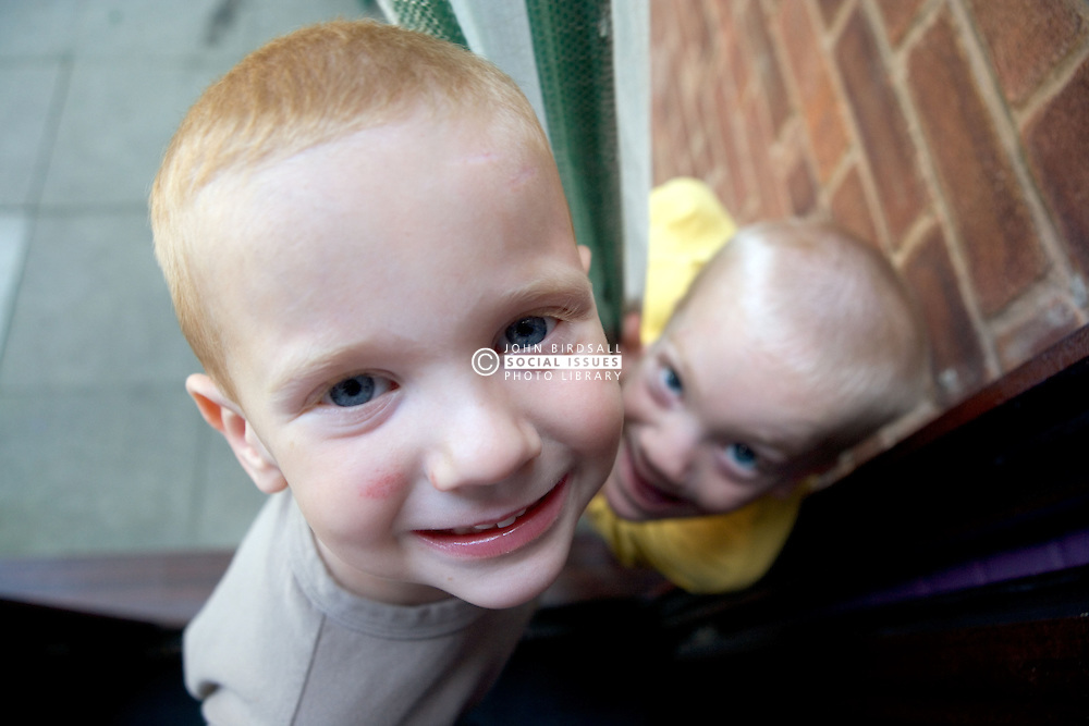Two brothers smiling up at the camera,