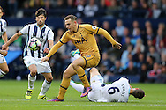 Vincent Janssen of Tottenham Hotspur gets away from the tackle from Jonny Evans of West Brom (6). Premier league match, West Bromwich Albion v Tottenham Hotspur at the Hawthorns stadium in West Bromwich, Midlands on Saturday 15th October 2016. pic by Andrew Orchard, Andrew Orchard sports photography.