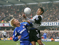 Photo: Lee Earle.<br /> Millwall v Everton. The FA Cup. 07/01/2006. Millwall's Zak Whitbread (L) battles with Tim Cahill.