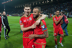ZENICA, BOSNIA & HERZEGOVINA - Saturday, October 10, 2015: Wales Ben Davies and Wales Ashley Richards celebrate after securing a place at next years Euro Championships after the Bosnia & Herzegovina vs Wales match at the Stadion Bilino Polje during the UEFA Euro 2016 qualifying Group B match. (Pic by Peter Powell/Propaganda)