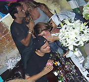 **EXCLUSIVE**.Leonardo playing cards.Leonardo DiCaprio & Gisele Bundchen attending a Birthday Party for Giselle's .Leonardo playing cards.IMG Agent Anne Nelson..PM Lounge.New York, NY USA.Tuesday, July 06, 2004.Photo By Celebrityvibe.com/Photovibe.com, New York, USA, Phone 212 410 5354, email:sales@celebrityvibe.com...