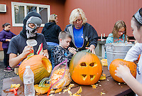 Cristian, Connor, Kathy Drouin, Leah and Allie get to work carving pumpkins at the Laconia Boys and Girls Club for Pumpkin Fest on Saturday.  (Karen Bobotas/for the Laconia Daily Sun)
