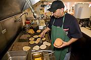 Lourdes' husband grills tortillas at Lourdes Alvarez's Mexican Restaurant El Coyote, in Alsip, Chicago.  (Lourdes Alvarez is featured in the book What I Eat;  Around the World in 80 Diets.)