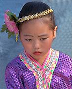 Girl age 6 wearing traditional dress at Asian American Festival.  St Paul  Minnesota USA