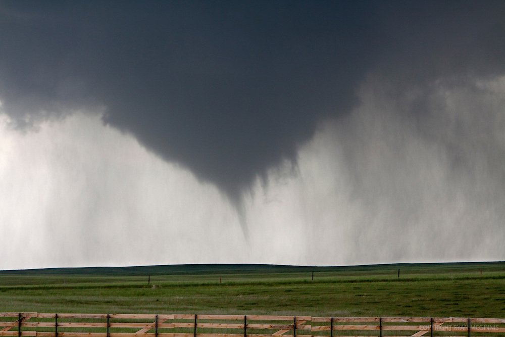 A tornado lowers from the sky in Goshen County, Wyoming, USA, June 5, 2009.  Shot during Project Vortex 2.  Project Vortex 2 is a two year National Science Foundation and NOAA funded science mission to study tornadoes and supercell thunderstorms.