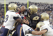Navy safety Wyatt Middleton (#8, left) recovers Army quarterback Trent Steelman's fumble at the 2 - yard line in the second half of the 111th. Army - Navy game at Lincoln Financial Field in Philadelphia, PA on Saturday, December 11, 2010. Middleton ran for a 98 - yard touchdown on the play and was named the game's MVP. Navy defeated Army 31 -17.