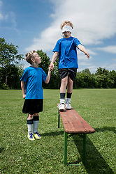 Young soccer players learning trust courage