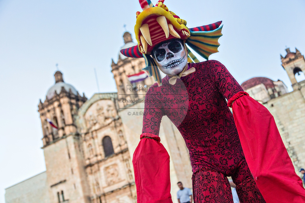 A young man dressed as a skeleton on circus stilts outside the Santo Domingo Church during the Day of the Dead Festival known in spanish as Día de Muertos October 25, 2014 in Oaxaca, Mexico.