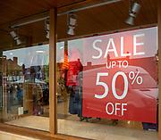 Sale 50% off Landmark shop window, High street shopping Marlborough, Wiltshire, England, UK - January 2021