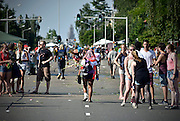 Nederland, Nijmegen, 18-7-2014Het vierdaagselegioen loopt over de Via Gladiola Nijmegen binnen. Na een feestelijke intocht volgt de uiteindelijke finish en het ophalen van het kruisje, vierdaagsekruisje, op de Wedren. Voor de laatste lopers is het echt doorzetten om op tijd binnen te zijn. Vanwege de vliegramp boven de Oekraine is de intocht sterk versoberd. Geen marsmuziek of muziek van groepen.The International Four Day Marches Nijmegen (or Vierdaagse) is the largest marching event in the world. It is organized every year in Nijmegen mid-July as a means of promoting sport and exercise. Participants walk 30, 40 or 50 kilometers daily, and on completion, receive a royally approved medal, Vierdaagsekruis. ~The participants are mostly civilians, but there are also a few thousand military participants. In 2004 a restriction on the maximum number of registrations is 45,000 registrations. More than a hundred countries have been represented in the Marches over the years. Foto: Flip Franssen/Hollandse Hoogte