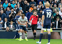 Football - 2019 / 2020 Premier League - Tottenham Hotspur vs. Watford<br /> <br /> Referee Chris Kavanagh points to the spot after VAR decision at The Tottenham Hotspur Stadium.<br /> <br /> COLORSPORT/DANIEL BEARHAM