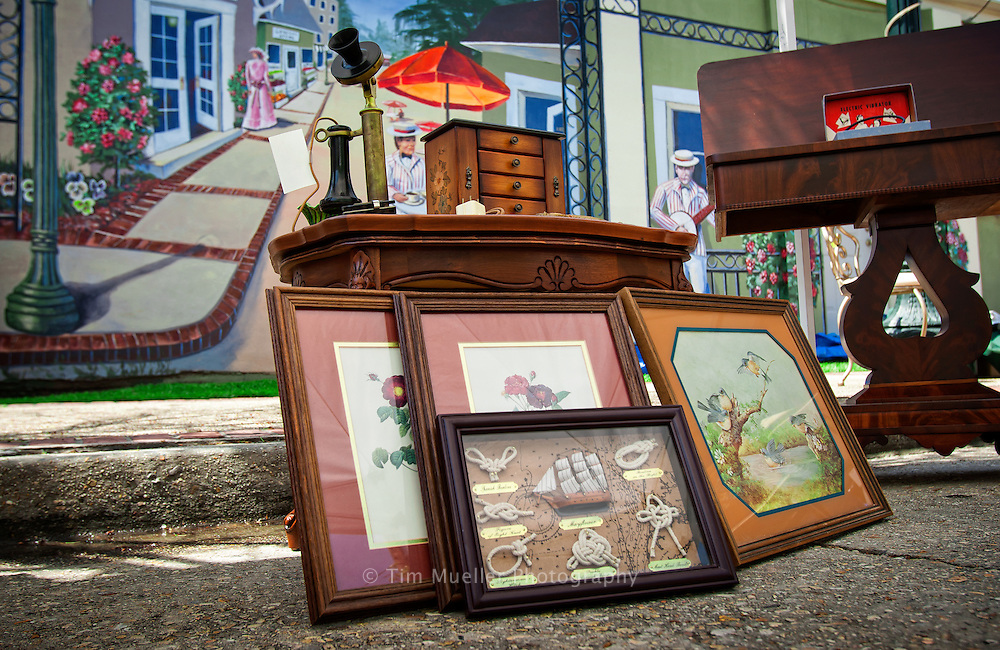 Art and antique furniture from Treasures Found, LLC lines the street in Slidell's Olde Towne during an Antique Fair.