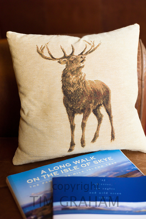 Red deer cushion and country walks guide book at luxurious Ullinish Lodge Hotel at Struan, Isle of Skye, Western Isles of Scotland
