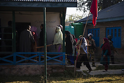 October 8, 2018 - Srinagar, Jammu and Kashmir, India - Kashmiris enter a polling station to cast their votes during the first phase of municipal polls,  on October 8, 2018 in Srinagar, the summer capital of Indian administered Kashmir, India. Indian-administered Kashmir shut on the call of pro-independence groups to mark the first phase of municipal polls being held by India in the disputed Himalayan region on Monday. The restive Kashmir valley witnessed just 17.5 polling percentage till 3 pm, officials said.  Pro-independence groups had called for a shutdown to mark the polls while pro-India parties like the National Conference and Peoples Democratic Party decided to stay away from the process, citing New Delhis attempts to alter the special status accorded to the region in the Indian constitution. (Photo by Kabli Yawar /Nur Photos) (Credit Image: © Kabli Yawar/NurPhoto/ZUMA Press)