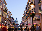 The busy Calle Larios shopping area at dusk in downtown Malaga, Spain