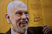 Rude anti-Boris Johnson graffiti on a poster for a West End show starring US actor John Malkovich in London, United Kingdom.