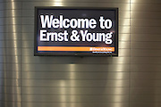 TV screen displaying corporate greeting message at main entrance of auditing company Ernst & Young's London headquarters