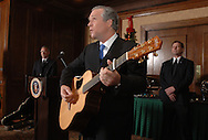 An impersonator of President George W. Bush, center, sings for an audience during a banquet in Orlando, Florida.