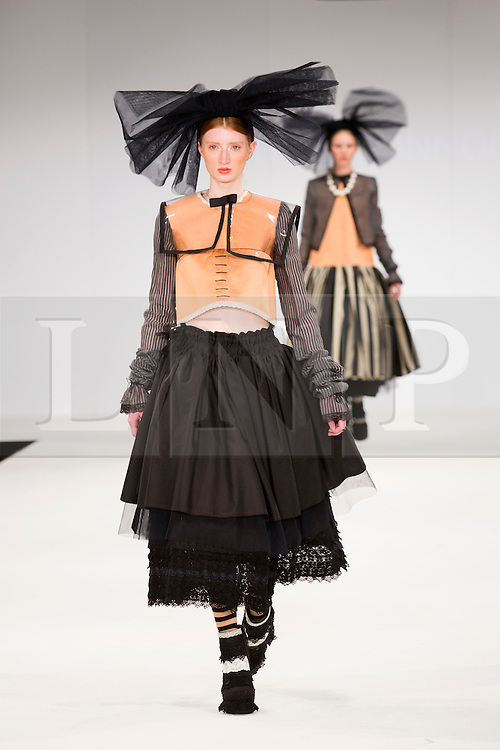 © Licensed to London News Pictures. 30/05/2015. London, UK. A model walks the runway during the UCA Rochester fashion show at Graduate Fashion Week 2015 wearing the collection of graduate student Maurice Connolly. Graduate Fashion Week takes place from 30 May to 2 June 2015 at the Old Truman Brewery, Brick Lane. Photo credit : Bettina Strenske/LNP