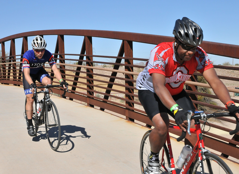 Two participants heading straight into a 25 mph headwind. The wind never led up on Old Pueblo Gran FUNdo participants.