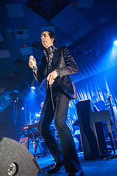 A wide angle shot of the frontman Nick Cave back to the stage, Nick Cave and the Bad Seeds, on stage tonight at The Barrowlands, Glasgow, Scotland.<br /> ©Michael Schofield.