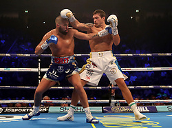 Tony Bellew (left) in action against Oleksandr Usyk during their WBC, WBA, IBF, WBO & Ring Magazine Cruiserweight World Championship bout at Manchester Arena.