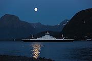 The car ferry Tidesund sailing to Hareid, lit up by fullmoon (supermoon)   Fergen Tidesund fra Norled på vei inn til Hareid, opplyst av fullmånen (supermåne).