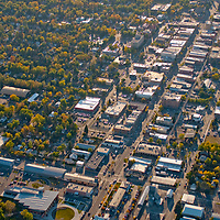 Aerial view looking down Main Street in Bozeman, Montana.  The Bozeman Public Library is lower left, Montana State University upper left.