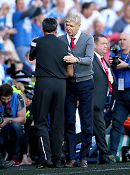 Arsenal manager Arsene Wenger (right) and Huddersfield Town manager David Wagner shake hands at the end of the match