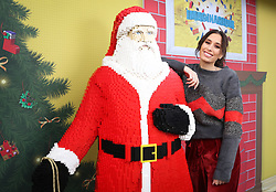 EDITORIAL USE ONLY<br /> Stacey Solomon with a model of Santa Claus at the LEGO Imaginarium, which is open for this weekend only on London's Southbank.
