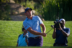 August 5, 2018 - Reno, Nevada, U.S - Sunday, August 5, 2018.SAM SAUNDERS, Arnold Palmer's grandson, hits onto the 18th green during the 2018 Barracuda Championship at the Montreux Golf & Country Club in Reno, Nevada...The Barracuda Championship Golf Tournament is one of only 47 stops on the PGA Tour worldwide, and has donated nearly $4 million to charity since 1999. Opened in 1997, the par-72 course was designed by Jack Nicklaus, plays at 7,472 yards (6,832 m) and its average elevation is 5,600 feet (1,710 m) above sea level...The Montrux Golf and Country Club is located midway between Reno and Lake Tahoe...The tournament champion, Andrew Putnam, received a check in the amount of $612,000. (Credit Image: © Tracy Barbutes via ZUMA Wire)