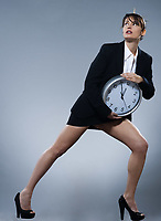 beautiful woman on isolated backgound holding a clock