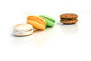 Stack of multicolour macaroon biscuits isolated on white.