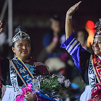 Tasha Yamutewa, right, and her sister Ashley Yamutewa wave to the crowd after they were crowned Miss Zuni and Junior Miss Zuni during the Zuni Fair Saturday in Zuni.