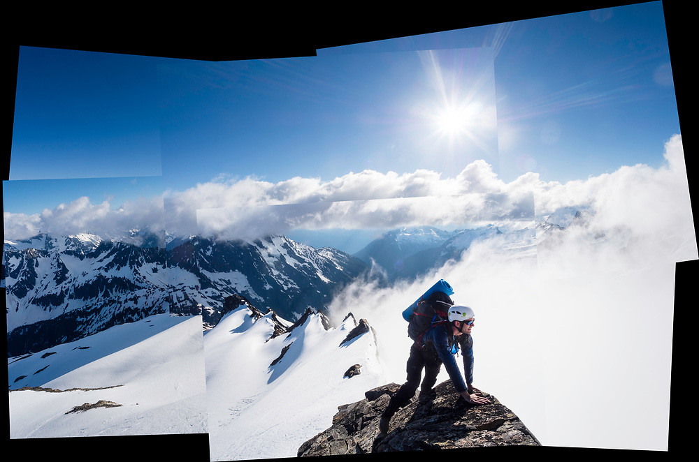 Obadiah Reid climbs the summit pyramid of Sahale Mountain, North Cascades National Park, Washington.