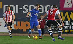 Alex Woodyard of Peterborough United takes on the Exeter City defence - Mandatory by-line: Joe Dent/JMP - 04/12/2018 - FOOTBALL - St James Park - Exeter, England - Exeter City v Peterborough United - Checkatrade Trophy