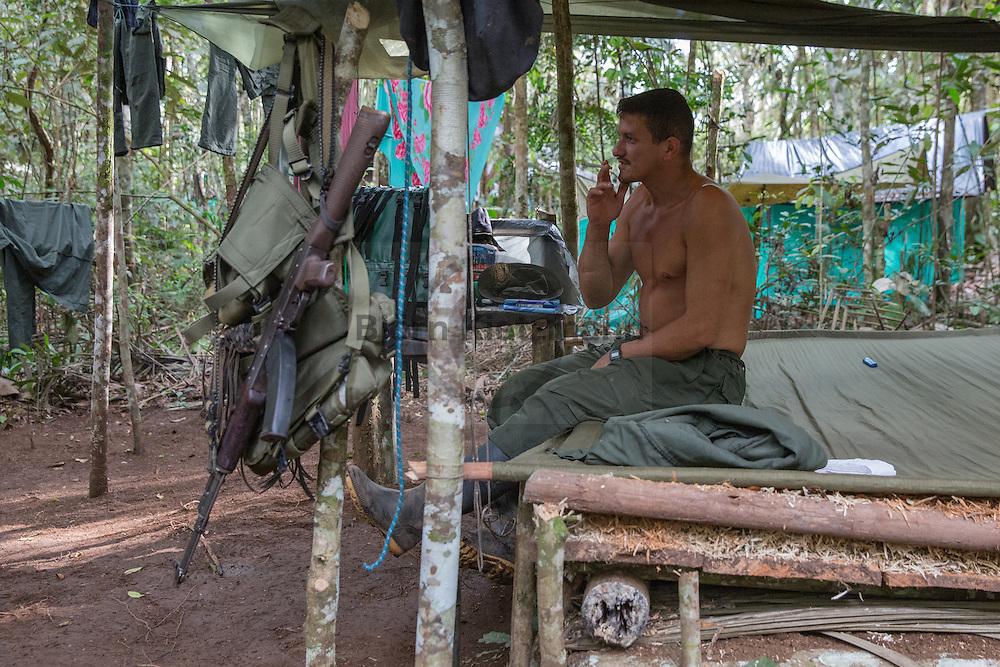 El Diamante, Meta, Colombia - 16.09.2016        <br /> <br /> Guerilla camp during the 10th conference of the marxist FARC-EP in El Diamante, a Guerilla controlled area in the Colombian district Meta. Few days ahead of the peace contract passing after 52 years of war with the Colombian Governement wants the FARC decide on the 7-days long conferce their transformation into a unarmed political organization. <br /> <br /> Guerilla-Camps zur zehnten Konferenz der marxistischen FARC-EP in El Diamante, einem von der Guerilla kontrollierten Gebiet im kolumbianischen Region Meta. Wenige Tage vor der geplanten Verabschiedung eines Friedensvertrags nach 52 Jahren Krieg mit der kolumbianischen Regierung will die FARC auf ihrer sieben taegigen Konferenz die Umwandlung in eine unbewaffneten politischen Organisation beschließen. <br />  <br /> Photo: Bjoern Kietzmann