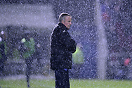 Kenny Jackett, the manager of Portsmouth looks on in the heavy rain. EFL Skybet Football League one match, Northampton Town v Portsmouth at the Sixfields Stadium in Northampton on Tuesday 12th September 2017. <br /> pic by Bradley Collyer, Andrew Orchard sports photography.