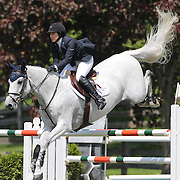 Sydney Shulman riding Quidam 13 in action during the $100,000 Empire State Grand Prix presented by the Kincade Group during the Old Salem Farm Spring Horse Show, North Salem, New York,  USA. 17th May 2015. Photo Tim Clayton