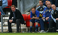 Photo: Paul Thomas.<br />Wigan Athletic v Portsmouth. The Barclays Premiership. 29/04/2006.<br /><br />Portsmouth manager Harry Redknapp (L) and his staff look dejected as Wigan take the lead.